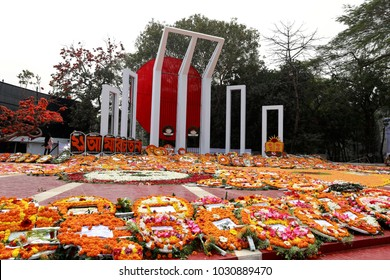 DHAKA, BANGLADESH - FEBRUARY 21, 2018: The Central Shaheed Minar is flooded with flowers placed by thousands of people as homage of International Mother Language day in Dhaka, Bangladesh.
