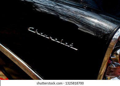 Dhaka, Bangladesh. February 21, 2019. Calligraphy logo of 1956 Chevrolet Station wagon. Business men had a choice with 2 1956 Chevrolet Handyman models. Now it's a vintage car.