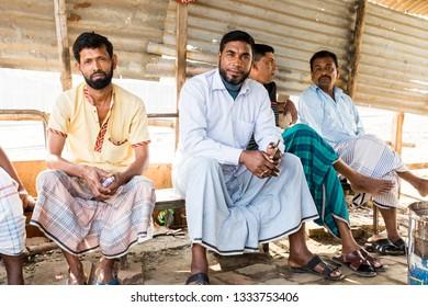 Dhaka, Bangladesh, February 24 2017: Taxi drivers take a break and wait for passengers on a ship dock in Dhaka Bangladesh