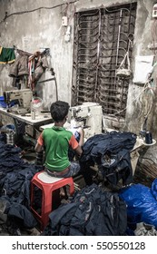 DHAKA, BANGLADESH - JANUARY 06, 2017: Child labor in a garment factory in Bangladesh