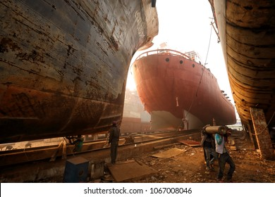 DHAKA - BANGLADESH - JANUARY 10, 2018: Unidentified dock workers in a shipyard on January 10, 2018 in Dhaka, Bangladesh. Shipbuilding in Bangladesh has become a major industry in recent years.