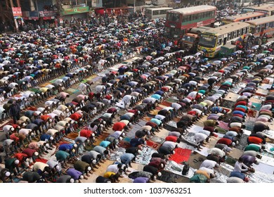 DHAKA - BANGLADESH - JANUARY 12, 2018: Unidentified Muslim pilgrims pray at the Bishwa Ijtema on January 12, 2018 in Dhaka, Bangladesh. Bishwa Ijtema is the largest Islamic congregation of the world.