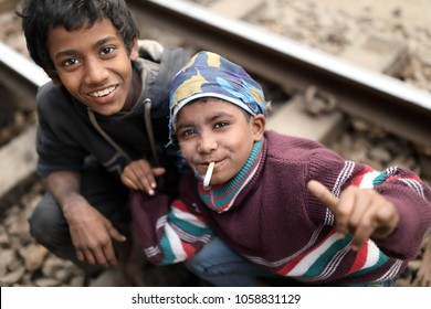 DHAKA - BANGLADESH - JANUARY 13, 2018: Unidentified street children in a railway station on January 13, 2018 in Dhaka, Bangladesh. Bangladesh has an estimated number of above 670,000 street children