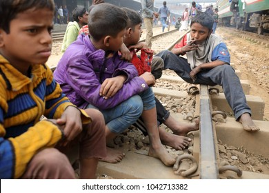 DHAKA - BANGLADESH - JANUARY 14, 2018: Unidentified street children in a railway station on January 14, 2018 in Dhaka, Bangladesh. Bangladesh has an estimated number of above 670,000 street children