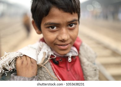 DHAKA - BANGLADESH - JANUARY 14, 2018: Unidentified street child in a railway station on January 14, 2018 in Dhaka, Bangladesh. Bangladesh has an estimated number of above 670,000 street children
