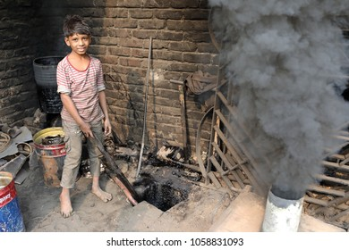 DHAKA - BANGLADESH - JANUARY 25, 2018: Unidentified child worker in a shipyard on January 25, 2018 in Dhaka, Bangladesh. Bangladesh has over 4.7 million child workers aged between 5 to 14.