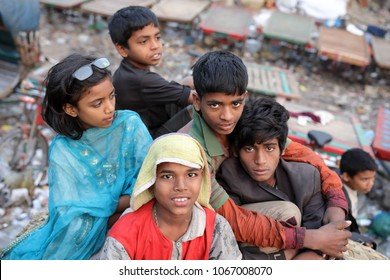 DHAKA - BANGLADESH - JANUARY 26, 2018: Unidentified street children sit at Sadarghat on January 26, 2018 in Dhaka, Bangladesh. Bangladesh has an estimated number of above 670,000 street children