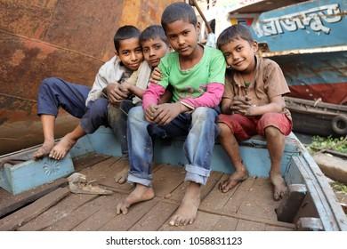 DHAKA - BANGLADESH - JANUARY 9, 2018: Unidentified street children at Sadarghat on January 9, 2018 in Dhaka, Bangladesh. Bangladesh has an estimated number of above 670,000 street children