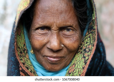 DHAKA - BANGLADESH - JANUARY 9, 2018: Unidentified market vendor in the market on January 9, 2018 in Dhaka, Bangladesh