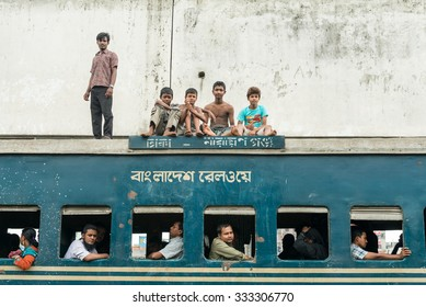 Dhaka, Bangladesh - July 19, 2014: Commuters in train looking through window. Trains are very cheap and poorly maintained but it's the best option to witness a bit of everyday local life.