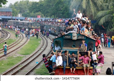 Dhaka, Bangladesh -June 03, 2019: Bangladeshi people risk their lives on top of trains as they travel to their hometowns ahead of the Muslim holiday of eid ul fitr, Dhaka, Bangladesh on June 03, 2019.