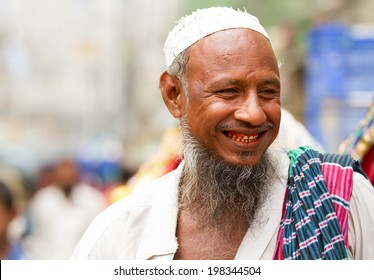 DHAKA, BANGLADESH - JUNE 6, 2014: A friendly Bangladeshi rickshaw puller in Old Dhaka shows happiness in the face of grinding poverty.