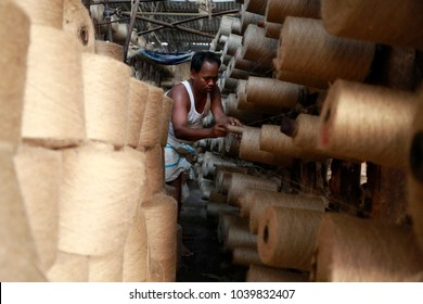 DHAKA, BANGLADESH - MARCH 05, 2018: Bangladeshi workers work in a jute factory on the outskirts of Dhaka, Bangladesh on March 05, 2018.