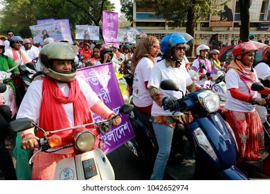DHAKA, BANGLADESH - MARCH 09, 2018: Female bikers take out a rally from Dhaka University's TSC with a slogan 'Fearless Women Will Build a Safe City' on Friday to mark International Women's Day.
