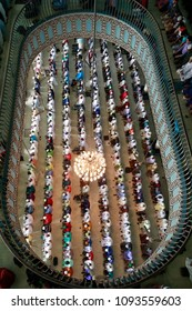 Dhaka, Bangladesh - May 18, 2018: Thousands of Muslims join the first jummah prayers during the month of Ramadan at the Baitul Mukarram Mosque in Dhaka, Bangladesh on May 18, 2018.