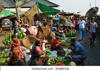 DHAKA, BANGLADESH - NOVEMBER 2: Locals are selling and buying fruits and vegetables at the food market on November, 2, 2014 in Dhaka, Bangladesh