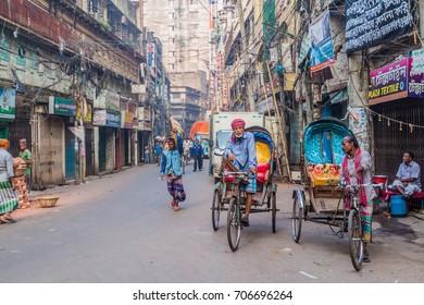 DHAKA, BANGLADESH - NOVEMBER 20, 2016: Cyclo rickshaw drivers in Old Dhaka, Bangladesh.