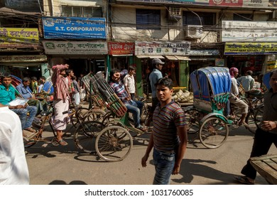 Dhaka / Bangladesh - November 2012: People on road with car, bikes and rickshaws, usual traffic in the capital of Bangladesh.