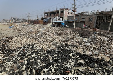 Dhaka, BANGLADESH - NOVEMBER 25, 2017: Wastage toxic lather materials dumped in an open field at the Savar tannery area on the banks of the Dhaleshwari River in Savar, near Dhaka, Bangladesh.