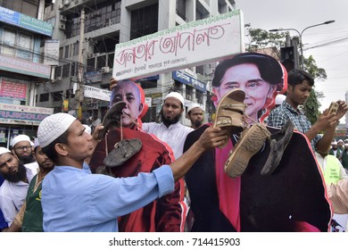 DHAKA, BANGLADESH - SEPTEMBER 13, 2017: Supporters of Bangladesh Islami Andolan puts shoes on Aung San Suu Kyi's picture as they take part in a protest and March towards Myanmar Embassy.