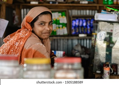 DHAKA, BANGLADESH - SEPTEMBER 14, 2019: Portrait of a traditional looking Bangladeshi with colorful clothes in a village