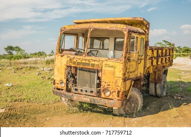 DHAKA, BANGLADESH - SEPTEMBER 16, 2017: A scrap Indian yellow Ashok Leyland Comet truck in Bangladesh in a very bad condition