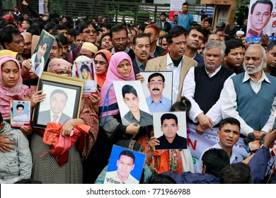 DHAKA, BANGLADESH-DECEMBER 10, 2017: Relatives of the missing people hold photos of their loved ones in their hands and tears in their eyes, gather in Dhaka with an appeal to get back their relatives.