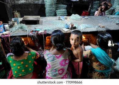 DHAKA, BANGLADESH-JUNE 19, 2016: Women work with hazardous condition in a bangle factory at Lalbag in Dhaka, Bangladesh. They are work manually with fire. According to the management of the factory.