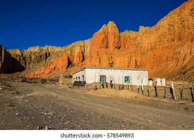 Dhakmar village and red rocks, Mustang, Nepal.