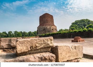 Dhamek Stupa is a massive stupa located at Sarnath, 13 km away from Varanasi in the state of Uttar Pradesh, India. Stupas originated as pre-Buddhist tumuli