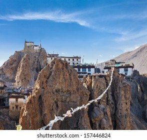 Dhankar gompa (Tibetan Buddhist monastery) and prayer flags (lungta). Dhankar, Spiti valley, Himachal Pradesh, India
