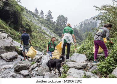 Dharamsala / India - July 12 2018: People from the NGO Waste Warriors on their cleaning day at the Bhagsu waterfall in the mountains on a cloudy afternoon.