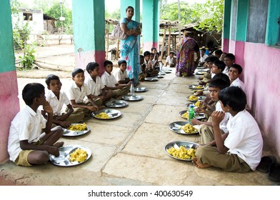 DHARNI, MAHARASHTRA, INDIA - JULY 9: Unidentified children get food at lunch time at school by project School feeding program provided by government of maharashtra,Dharni, Maharashtra, 9 July 2015.