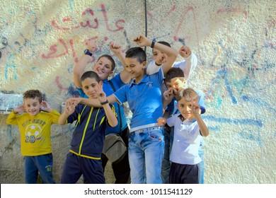 Dheisha, Bethlehem  Palestine - 10 11 2015: Kids in the refugee camp Dheisha smiling at the camera.