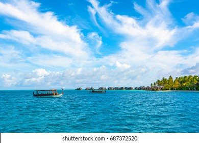 Dhidhoofinolhu, Maldives - 5 July 2017: Traditional wooden  boat  dhoni for tourist excursions  in the crystal water of the Indian Ocean, Maldives, 5 July 2017