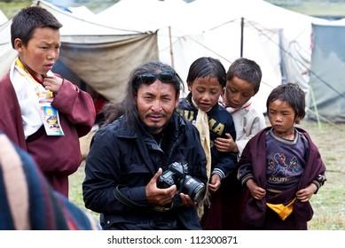 DHO TARAP, NEPAL - SEPTEMBER 11: Famous Tibetan actor Gurgon Kyap during Dho Tarap Full Moon Festival on September 11, 2011 in Dho Tarap Village, Dolpo district, Nepal