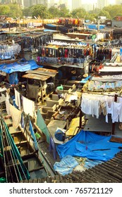 Dhobi Ghat (Mahalaxmi Dhobi Ghat) is a well known open air laundromat in Mumbai, India. The washers, locally known as dhobis, work in the open to wash the clothes from Mumbai's hotels and hospitals