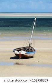 Dhow on a sand bank, Mozambique. Portrait.