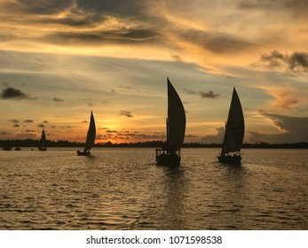 Dhow sailboats at sunset in Lamu Island, Kenya.