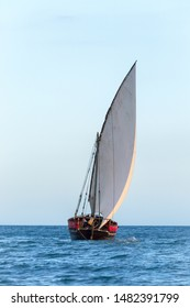 dhow sailing boat versatile large and powerful with a sturdy wooden hull and large powerful lateen sail set for a fine heading into wind