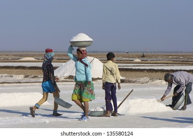 DHRANGADHRA, INDIA - MARCH 13: Unidentified group of salt workers, Little Rann of Kutch. On March 13, 2012 in Dhrangadhra, India.  India is world's 3rd largest producer of salt, 80% from Gujarat.