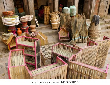 DHULKIHEL, NEPAL — NOVEMBER 3, 2018. Bamboo and straw products (baskets, stools, shelving, brooms) are displayed for sale outside a shop in Dhulikhel's old town.