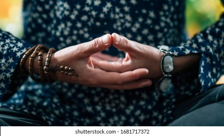 Dhyana Mudra. Hand gesture holding fingers in Dhyana Mudra for meditation, self-healing and improving concentration.