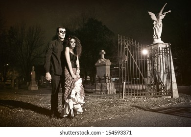 Dia de los Muerto Costume - Day of the dead is a mexican holiday. Here is a beautiful dead couple in a cemetery !