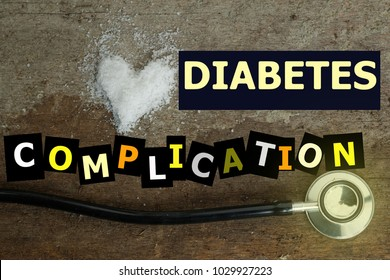DIABETES COMPLICATION word on wooden background