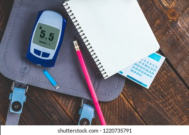 Diabetes concept. Control diabetes, monitor blood glucose levels, self control. Write blood glucose readings in the diary of self-control.