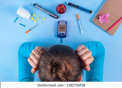 Diabetes. Diabetes concept. Tired of diabetes, high sugar, disease. Diabetic supplies on a blue background. Diabetic lifestyle