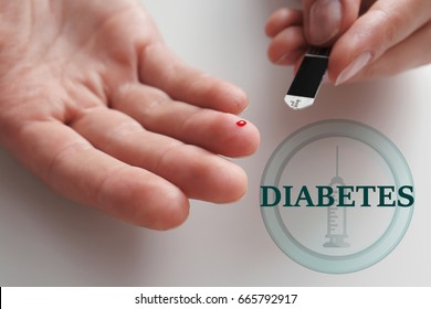 Diabetes concept. Woman checking glucose level in blood, closeup