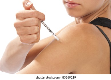 Diabetes dependent woman making insulin flu shot by syringe with dose of humalog, subcutaneous arm injection vaccination isolated on a white background