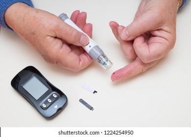 Diabetes finger prick blood test, type 2 diabetic using home monitoring glucometer